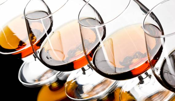 four glasses of strong cognac